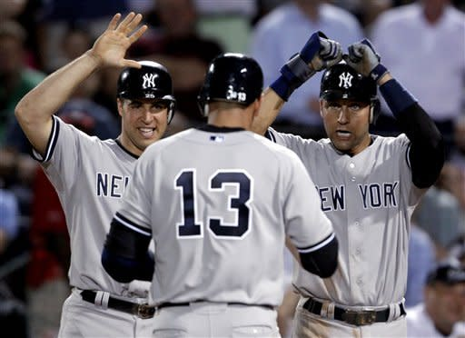 New York Yankees' Alex Rodriguez, center, gets high-fives from teammates Mark Teixeira, left, and Derek Jeter after hitting a grand slam in the eighth inning of a baseball game against the Atlanta Braves on Tuesday, June 12, 2012, in Atlanta. The Yankees won 6-4. (AP Photo/David Goldman)