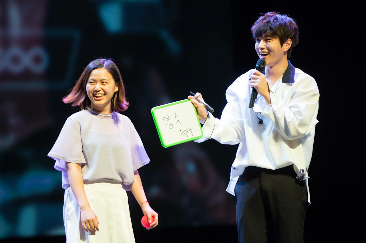 <p>INFINITE's Kim Myung-soo on stage with a fan at his first fan meeting in Singapore (Photo: PTO Entertainment Pte Ltd) </p>