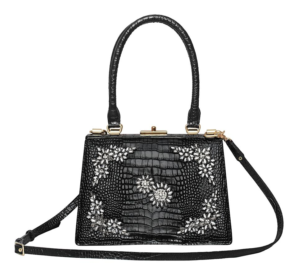 """<p>The miniature handbag made a return for SS17 thanks to the likes of Bella Hadid and Kendall Jenner's penchant for nineties-inspired accessories. And this season, it's all about the ladylike bag. <em><a rel=""""nofollow noopener"""" href=""""http://www2.hm.com/en_gb/index.html"""" target=""""_blank"""" data-ylk=""""slk:H&M"""" class=""""link rapid-noclick-resp"""">H&M</a>, £199.99</em> </p>"""