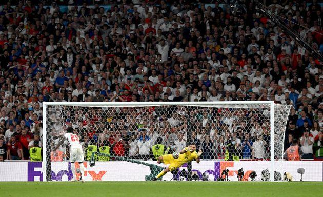 LONDON, ENGLAND - JULY 11: Bukayo Saka of England misses his team's fifth penalty in a penalty shoot out which is saved by Gianluigi Donnarumma of Italy during the penalty shoot out in the UEFA Euro 2020 Championship Final between Italy and England at Wembley Stadium on July 11, 2021 in London, England. (Photo by Paul Ellis - Pool/Getty Images) (Photo: Paul Ellis - Pool via Getty Images)