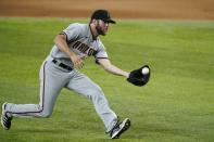 Arizona Diamondbacks relief pitcher Matt Peacock fields a grounder by Texas Rangers' David Dahl, who was out at first during the seventh inning of a baseball game in Arlington, Texas, Tuesday, July 27, 2021. (AP Photo/Tony Gutierrez)