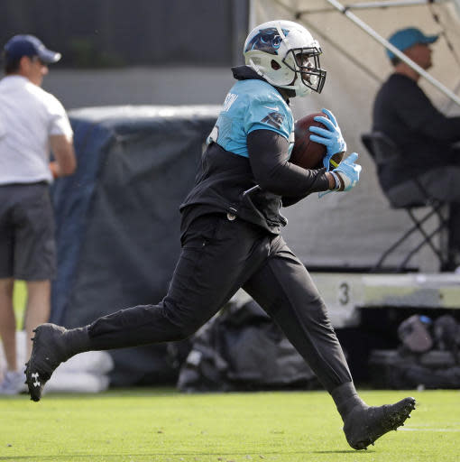 Carolina Panthers' C.J. Anderson runs a drill during practice at the NFL football team's facility in Charlotte, N.C., Tuesday, May 22, 2018. While NFL owners are voting to approve the new Panthers owner in Atlanta, the team David Tepper is about to officially own takes to the field for the OTAs back in Charlotte with plenty of new faces. (AP Photo/Chuck Burton)
