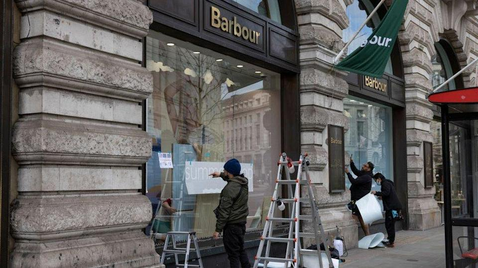 New window displays being created by staff at a store on Regent Street in London in preparation for reopening on 12 April
