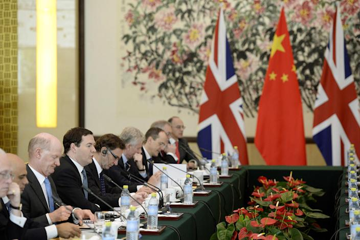 Britain's Chancellor of the Exchequer George Osborne, fourth from left, talks with Chinese Vice premier Ma Kai during a meeting at the Diaoyutai State Guesthouse in Beijing, Tuesday, Oct. 15, 2013. (AP Photo/Kota Endo, Pool)