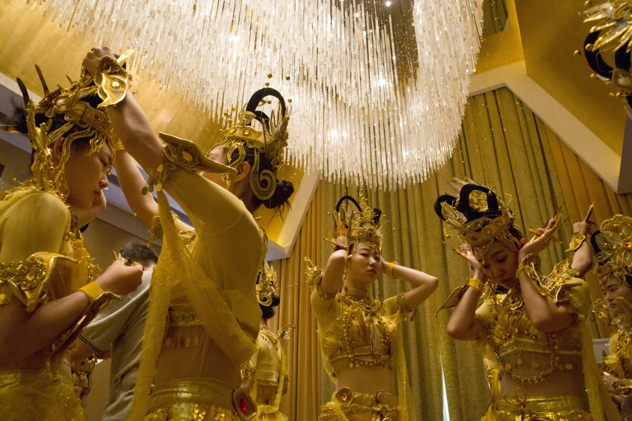 <p>Performers prepare backstage for rehearsals on May 17, 2016, ahead of the First World Conference on Tourism for Development to be held this week in Beijing. (Ng Han Guan/AP)</p>