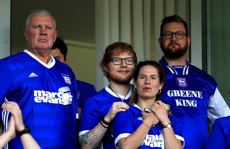 IPSWICH, ENGLAND - APRIL 21: Musician Ed Sheeran and fiance Cherry Seaborn look on during the Sky Bet Championship match between Ipswich Town and Aston Villa at Portman Road on April 21, 2018 in Ipswich, England. (Photo by Stephen Pond/Getty Images)