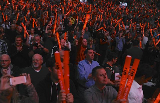 Portland Trail Blazers fans hold up their 'rip city' light sticks during the first half of game four of an NBA basketball first-round playoff series game in Portland, Ore., Sunday March 30, 2014. (AP Photo/Greg Wahl-Stephens)