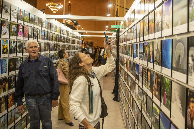 A woman takes a photo of her entries selected to be the exhibit. (Photo: Gordon Donovan/Yahoo News)