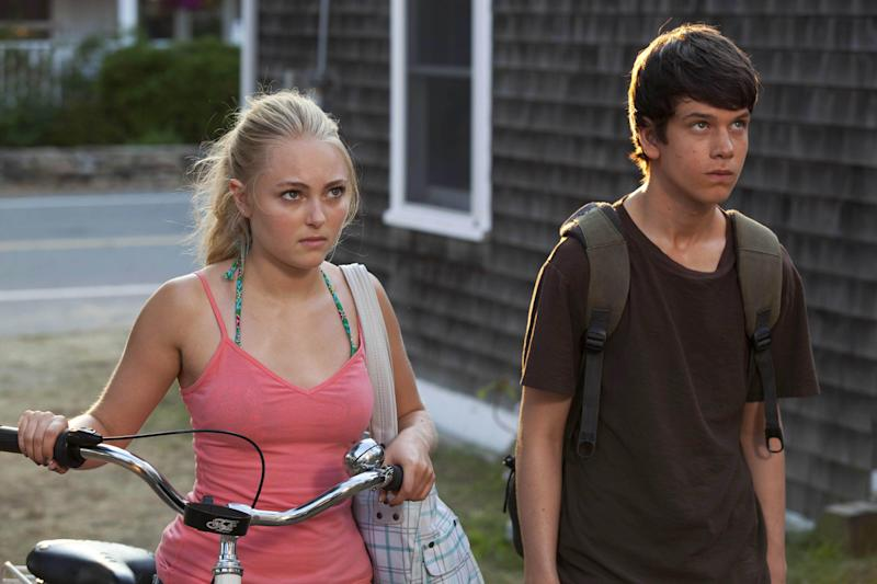 """This publicity photo released by Fox Searchlight shows AnnaSophia Robb, left, and Liam James in a scene from the film, """"The Way, Way Back."""" (AP Photo/Fox Searchlight, Claire Folger)"""