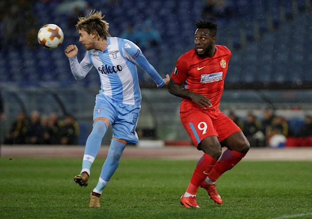 Soccer Football - Europa League Round of 32 Second Leg - Lazio vs Steaua Bucharest - Stadio Olimpico, Rome, Italy - February 22, 2018 Lazio's Patric in action with Steaua Bucharest's Harlem Gnohere REUTERS/Max Rossi