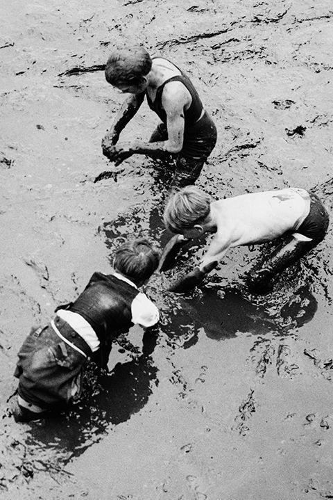 "<p>Typically an occupation dominated by those in extreme poverty, mudlarks scavenged through river mud in search of valuable items that were resold to the public. In 1904 this job was <a href=""https://en.wikipedia.org/wiki/Mudlark"" rel=""nofollow noopener"" target=""_blank"" data-ylk=""slk:viewed as unlawful"" class=""link rapid-noclick-resp"">viewed as unlawful</a> and was frowned upon.</p>"
