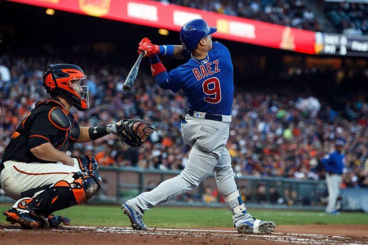 Javier Baez hits a pitch just inside the walls of AT&T Park, and his rapid sprint around the bases helped the Cubs go ahead by two runs in the second inning against the San Fransisco Giants (Getty Images).