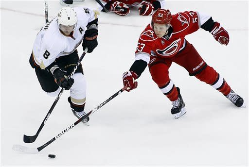Carolina Hurricanes' Jeff Skinner (53) battles with Anaheim Ducks' Teemu Selanne (8), of Finland, during the second period of an NHL hockey game in Raleigh, N.C., Thursday, Feb. 23, 2012. (AP Photo/Karl B DeBlaker)