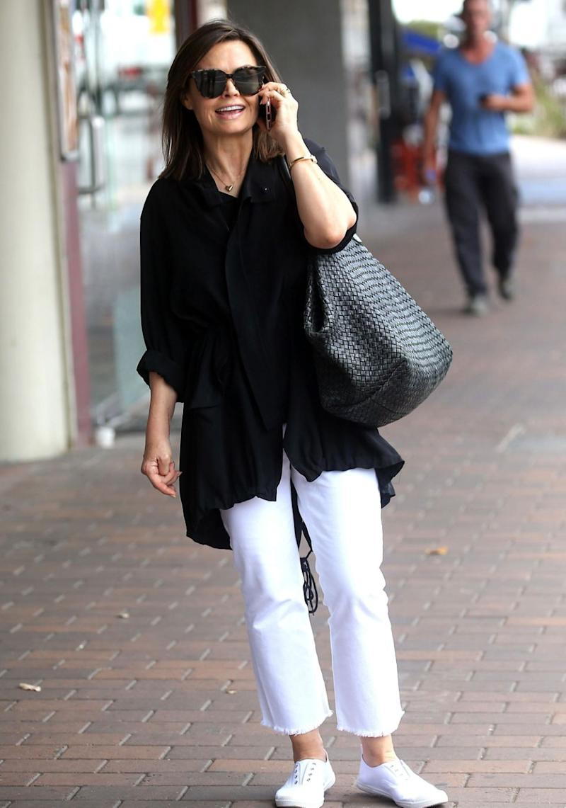 She sported a black blouse teamed with a pair of white trousers. Source: Diimex