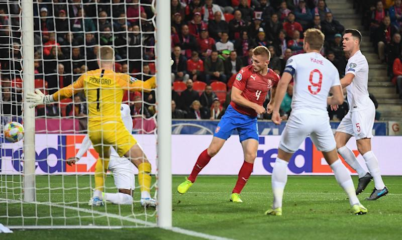 England's goalkeeper Jordan Pickford (L) fails to save Czech Republic's defender Jakub Brabec's (2nd L) goal during the UEFA Euro 2020 qualifier Group A football match Czech Republic v England at the Sinobo Arena on October 11, 2019. (Photo by JOE KLAMAR / AFP) (Photo by JOE KLAMAR/AFP via Getty Images)