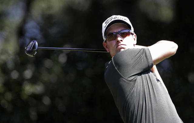 Adam Scott, of Australia, hits from the tee on the third hole during the first round of play in the PGA Tour Championship golf tournament at East Lake Golf Club in Atlanta, Thursday, Sept. 19, 2013. (AP Photo/John Bazemore)