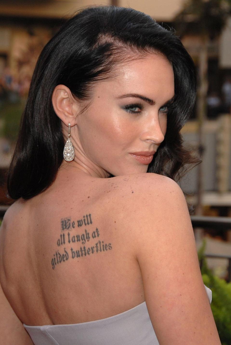 """<p>On her right shoulder, Fox has a quote inspired by Shakespeare's play """"King Lear."""" It reads """"We will all laugh at gilded butterflies."""" This tattoo is over a decade old. </p>"""