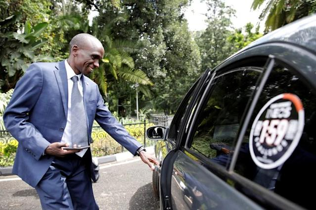 Kipchoge, the marathon world record holder, enters a car after an Interview with Reuters at the state house in Nairobi