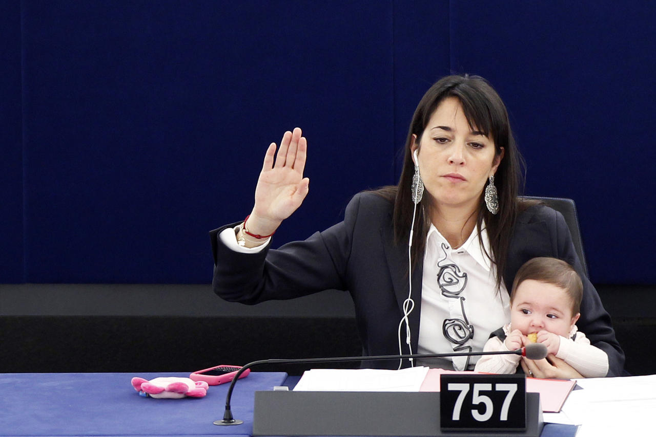 Member of the European Parliament Ronzulli of Italy holds her baby during a voting session at the European Parliament