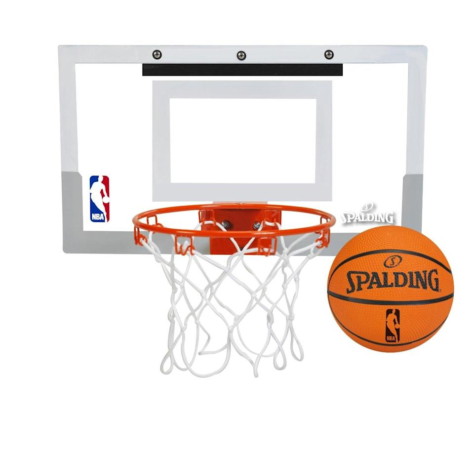 <p>You probably can't build a basketball court in their bedroom, but this <span>Spalding NBA Over-the-Door Mini Basketball Hoop</span> ($35) will still score big time!</p>