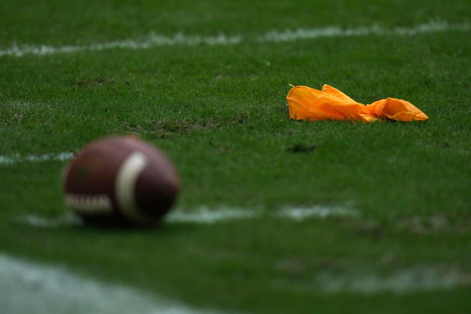 A general view of a penalty flag and football on the field during the second half between the Miami Hurricanes and the Michigan State Spartans at Hard Rock Stadium in Miami Gardens, Fla. on Sept. 18, 2021.