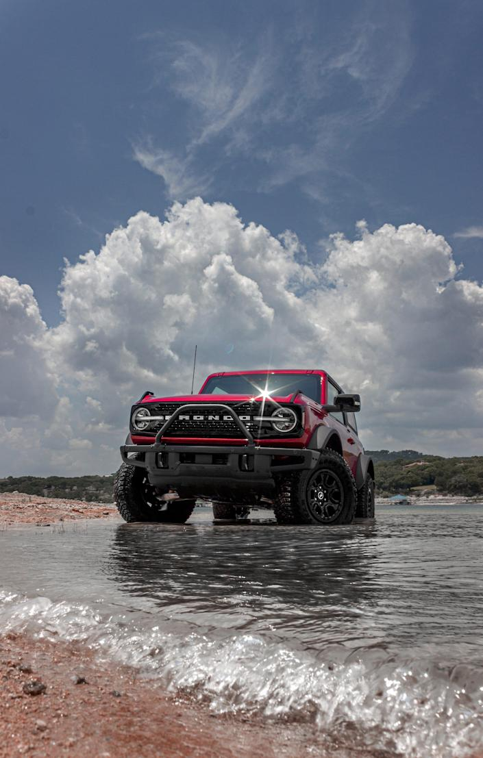 The Ford Bronco in a lake.