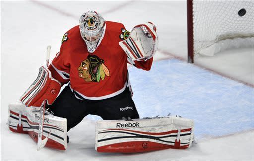Chicago Blackhawks goalie Corey Crawford misses a goal scored by St. Louis Blues' Adam Cracknell during the first period of an NHL hockey game in Chicago, Thursday, April 4, 2013. (AP Photo/Paul Beaty)
