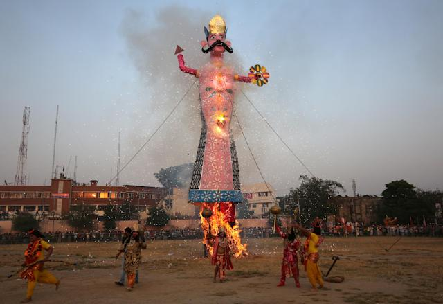 <p>Artists dressed as Hindu gods react as an effigy of Kumbhkarana, brother of demon king Ravana, burns during Vijaya Dashmi or Dussehra festival celebrations in Jammu, India, Sept. 30, 2017. (Photo: Mukesh Gupta/Reuters) </p>