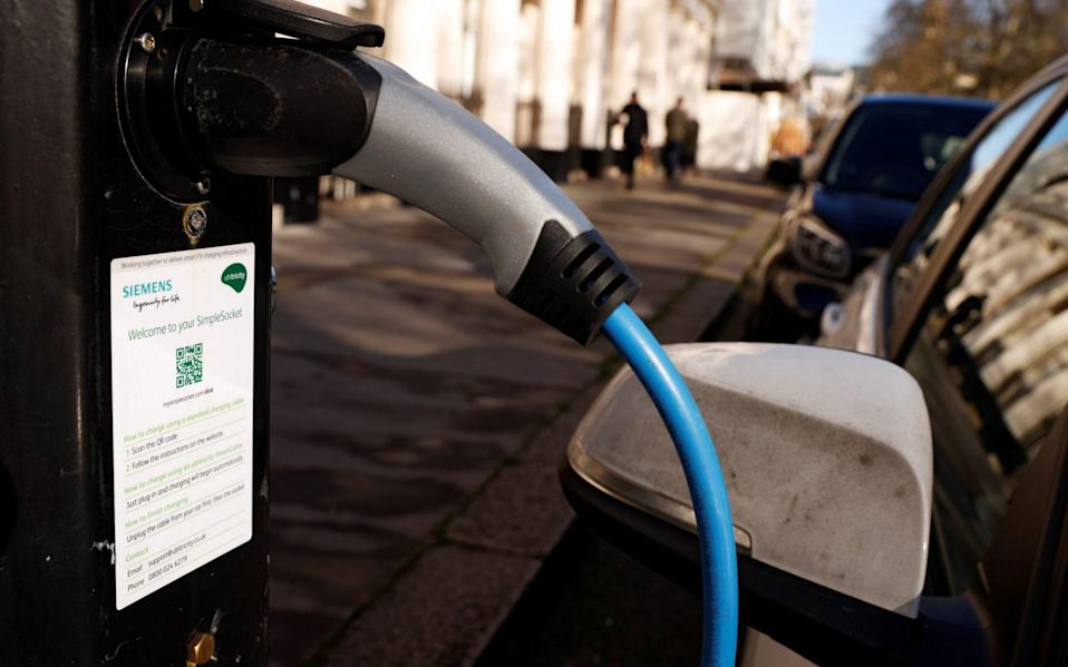 A vehicle is seen charging at an Ubitricity on-street electric vehicle charging point in London
