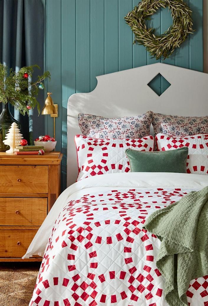 """<p>Holiday decorations aren't only meant for the living room. Upgrade your bedroom for the season with a simple wreath and tabletop items, including a mini Christmas tree.</p><p><b>RELATED: </b><a href=""""https://www.goodhousekeeping.com/holidays/christmas-ideas/how-to/g1253/diy-christmas-wreaths/"""" rel=""""nofollow noopener"""" target=""""_blank"""" data-ylk=""""slk:70+ Striking Christmas Wreaths"""" class=""""link rapid-noclick-resp"""">70+ Striking Christmas Wreaths</a></p>"""