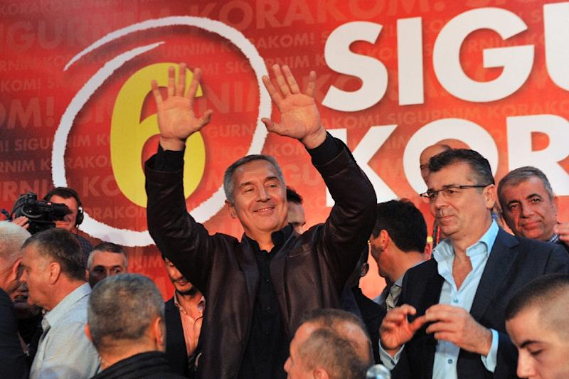 Montenegrin Prime Minister Milo Djukanovic and leader of ruling Democratic Party of Socialists celebrates after parliamentary elections in Podgorica on October 17, 2016 (AFP Photo/Savo Prelevic)