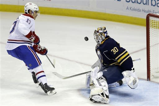 Buffalo Sabres' Ryan Miller (30) stops a shot by Montreal Canadiens' Rene Bourque (17) during the second period of an NHL hockey game in Buffalo, N.Y., Thursday, Feb. 7, 2013. (AP Photo/David Duprey)