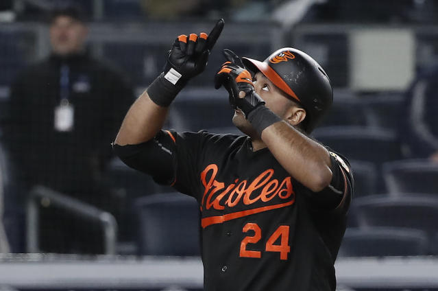 Baltimore Orioles first baseman Pedro Alvarez gestures after hitting a grand slam against the New York Yankees during the 14th inning of a baseball game early Saturday, April 7, 2018, in New York. (AP Photo/Julie Jacobson)