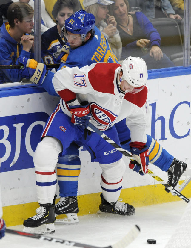 St. Louis Blues' Vladimir Tarasenko (91), of Russia, battles for the puck with Montreal Canadiens' Brett Kulak (17) during the third period of an NHL hockey game, Saturday, Oct. 19, 2019, in St. Louis. (AP Photo/Bill Boyce)