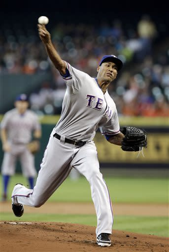 Texas Rangers' Alexi Ogando delivers a pitch against the Houston Astros in the first inning of a baseball game Friday, May 10, 2013, in Houston. (AP Photo/Pat Sullivan)