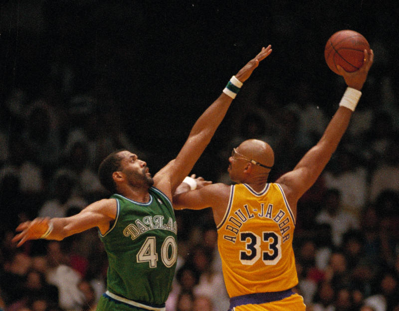 3100f69dd1d Kareem Abdul-Jabbar uses the skyhook against the Mavs' James Donaldson in  1988.