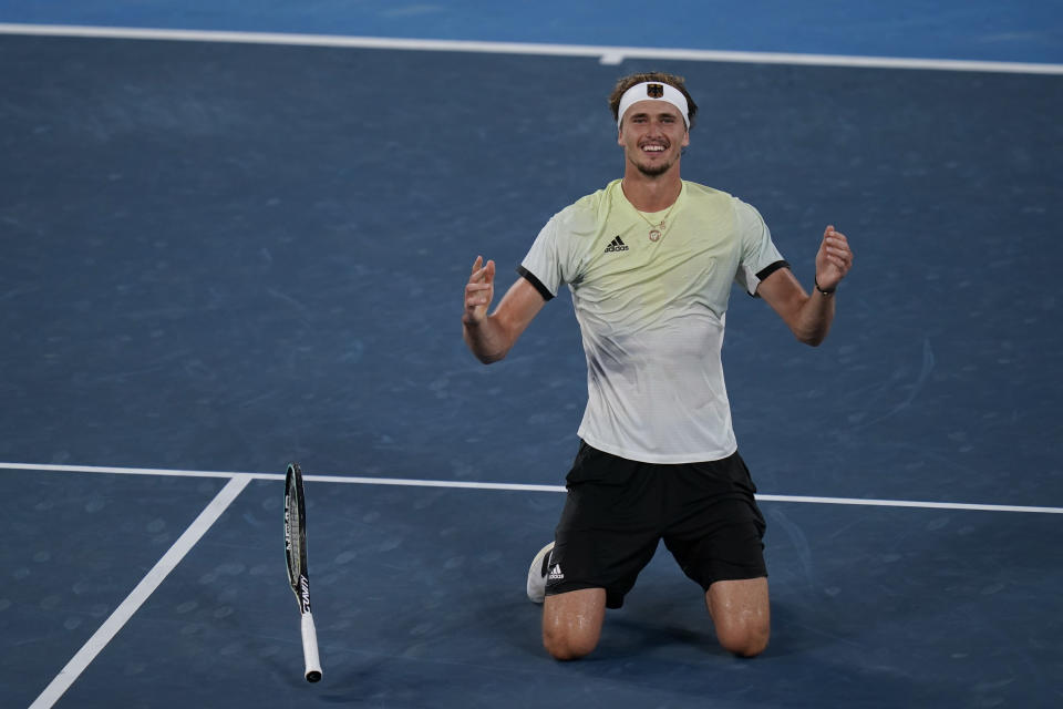 Alexander Zverev, of Germany, reacts after defeating Karen Khachanov, of the Russian Olympic Committee, in the men's single gold medal match of the tennis competition at the 2020 Summer Olympics, Sunday, Aug. 1, 2021, in Tokyo, Japan. (AP Photo/Seth Wenig)