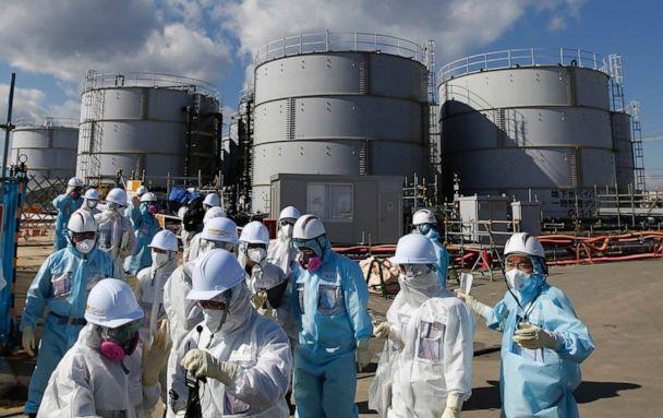 PHOTO: In this Feb. 10, 2016, file photo, media and employees receive a briefing from Tokyo Electric Power Co. in front of storage tanks for radioactive water at the Fukushima Dai-ichi nuclear power plant in Okuma, Fukushima Prefecture, Japan. (Toru Hanai/Pool via AP, FILE)