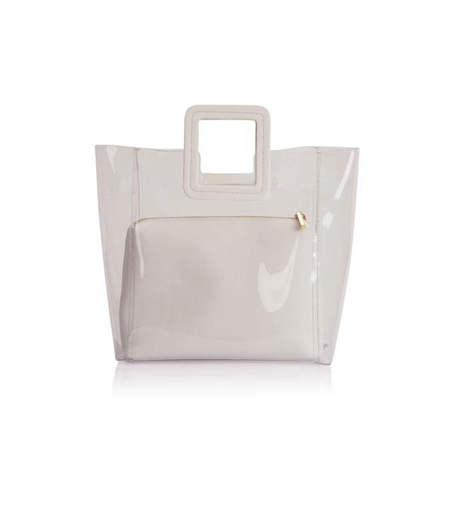 "<p><span>PVC and Leather Shirley Tote Bag, $210, <a href=""https://fivestoryny.com/products/shirley-pvc-tote-in-white"" rel=""nofollow noopener"" target=""_blank"" data-ylk=""slk:fivestory.com"" class=""link rapid-noclick-resp"">fivestory.com </a></span> </p>"