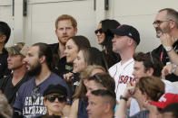 Britain's Prince Harry, top left, and Meghan, Duchess of Sussex, watch during the first inning of a baseball game between the Boston Red Sox and the New York Yankees, Saturday, June 29, 2019, in London. Major League Baseball made its European debut game today at London Stadium. (AP Photo/Tim Ireland)