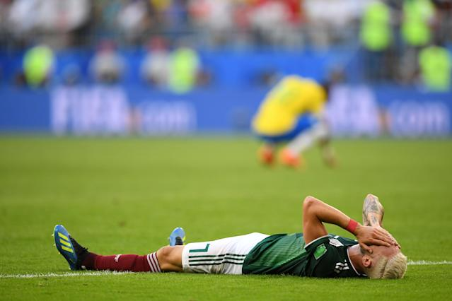 <p>Miguel Layun of Mexico shows his dejection following the 2018 FIFA World Cup Russia Round of 16 match between Brazil and Mexico at Samara Arena on July 2, 2018 in Samara, Russia. (Photo by Matthias Hangst/Getty Images) </p>