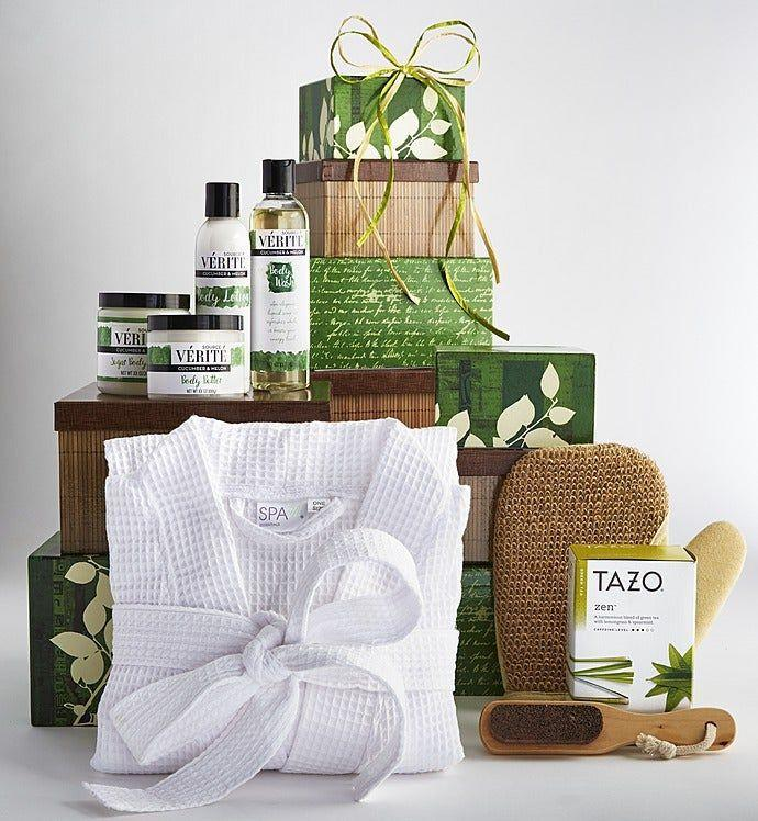 """<p><strong>1800 Baskets</strong></p><p>1800baskets.com</p><p><strong>$99.99</strong></p><p><a href=""""https://go.redirectingat.com?id=74968X1596630&url=https%3A%2F%2Fwww.1800baskets.com%2Fmoments-of-relaxation-spa-tower-149739%3Fsku%3D149739%26catalogId%3D13802%26storeId%3D20054%26r%3D18bdatafeedgoogle%26gclid%3DCjwKCAjwkoz7BRBPEiwAeKw3q9mINWnpkfaa88IczgiQ7bbwdy76H8w7D2Sn0rnsYKPuYm8_eHE8rRoCYCIQAvD_BwE&sref=https%3A%2F%2Fwww.goodhousekeeping.com%2Fholidays%2Fgift-ideas%2Fg34054234%2Fbest-gift-baskets-for-women%2F"""" rel=""""nofollow noopener"""" target=""""_blank"""" data-ylk=""""slk:Shop Now"""" class=""""link rapid-noclick-resp"""">Shop Now</a></p><p>Thanks to this spa gift basket, she can put self-care at the top of her list. Not only does it contain a waffle robe and exfoliating bath sponge, it also has a selection of cucumber melon-scented bath products (think shower gel, a sugar scrub, and a moisturizing body butter). </p>"""