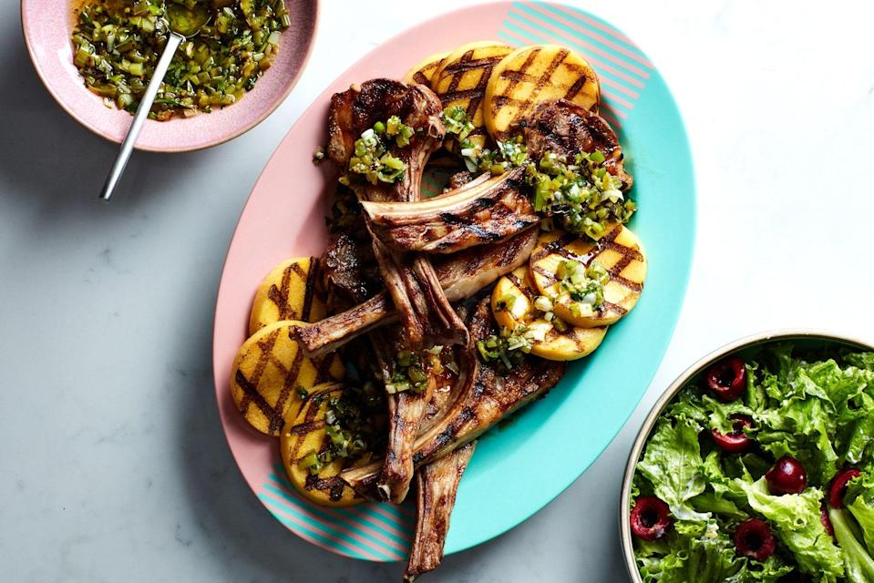 """Grill scallions and jalapeño alongside lamb chops and sliced polenta, then chop them up with fresh basil to make a zesty, spicy, smoky sauce that goes great with everything on the plate. A little bit of that sauce mixed with yogurt becomes an instant salad dressing for the accompanying salad of seasonal greens and cherries. <a href=""""https://www.epicurious.com/recipes/food/views/lamb-chops-with-polenta-and-grilled-scallion-sauce?mbid=synd_yahoo_rss"""" rel=""""nofollow noopener"""" target=""""_blank"""" data-ylk=""""slk:See recipe."""" class=""""link rapid-noclick-resp"""">See recipe.</a>"""