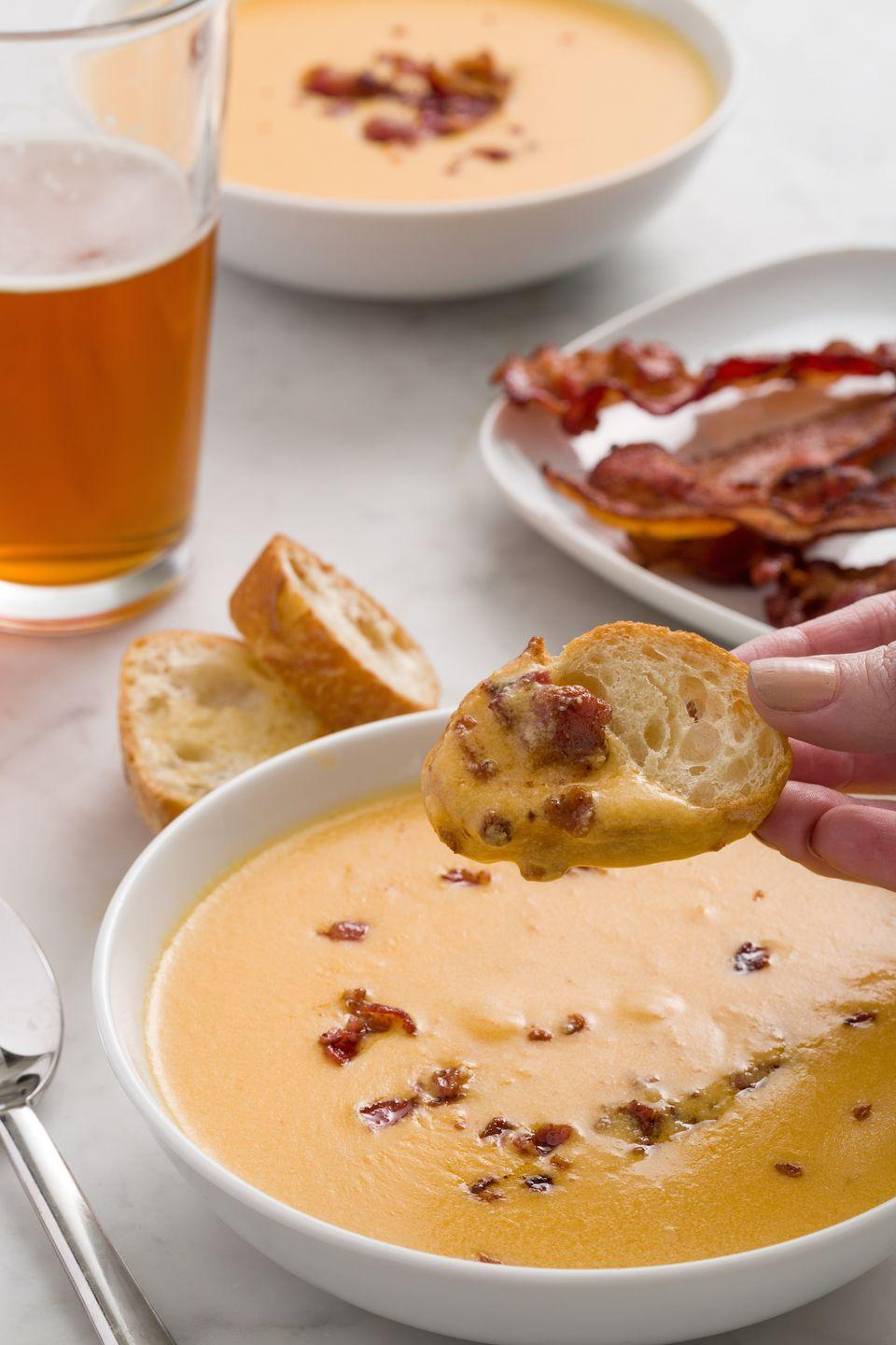"<p>Basically an excuse to essentially drink melty cheese. (Winning.) Beer and smoky bacon add depth.</p><p>Get the recipe from <a href=""https://www.delish.com/cooking/recipe-ideas/recipes/a44739/bacon-beer-cheese-soup-recipe/"" rel=""nofollow noopener"" target=""_blank"" data-ylk=""slk:Delish"" class=""link rapid-noclick-resp"">Delish</a>.</p>"