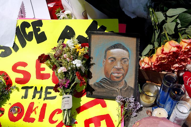 <strong>A chain portrait of George Floyd is part of the memorial for him near the site of the arrest.</strong> (Photo: ASSOCIATED PRESS)