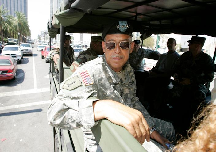 Army Lt. Gen. Russel Honore rides in a troop carrier as he goes to meetings with city and military officials in New Orleans in 2005.