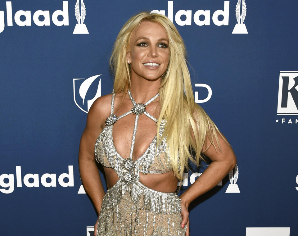 """FILE - In this April 12, 2018 file photo, Britney Spears arrives at the 29th annual GLAAD Media Awards in Beverly Hills, Calif. Spears is taking her act on the road this summer with her """"Piece of Me"""" world tour, traveling across North America and Europe. The first show is July 12 in Washington. (Photo by Chris Pizzello/Invision/AP, File)"""