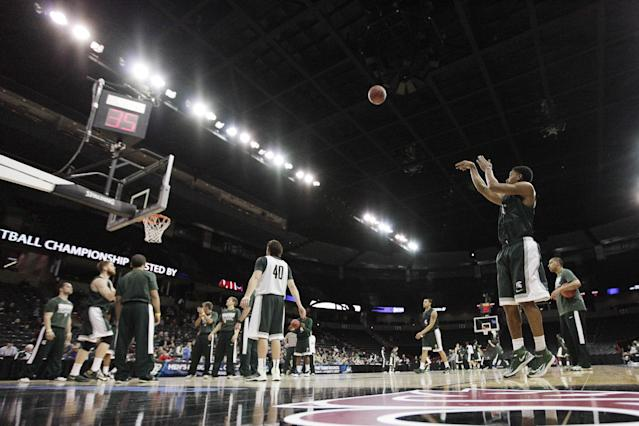 Michigan State's Gary Harris, front right, attempts a jump shot during practice for the NCAA college basketball tournament in Spokane, Wash., Wednesday, March 19, 2014. Michigan State plays against Delaware in a second-round game on Thursday. (AP Photo/Young Kwak)