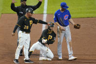 Pittsburgh Pirates' Hoy Park, center, kneels on third base after driving in two runs with a triple off Chicago Cubs relief pitcher Adam Morgan during the sixth inning of a baseball game in Pittsburgh, Tuesday, Sept. 28, 2021. (AP Photo/Gene J. Puskar)