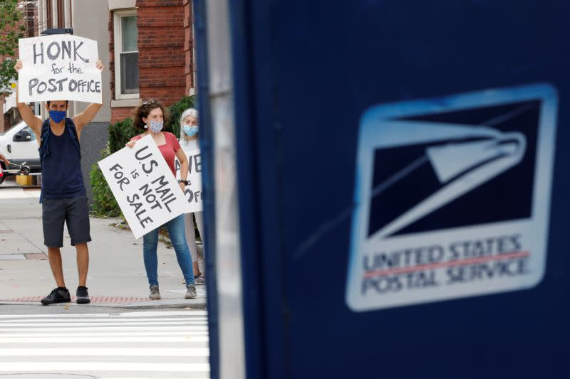 FILE PHOTO: People demonstrate in support of the U.S. Postal Service in Cambridge